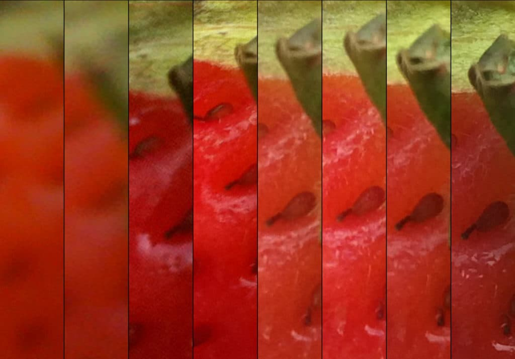 side-by-side images of a strawberry in order of increasing resolution quality